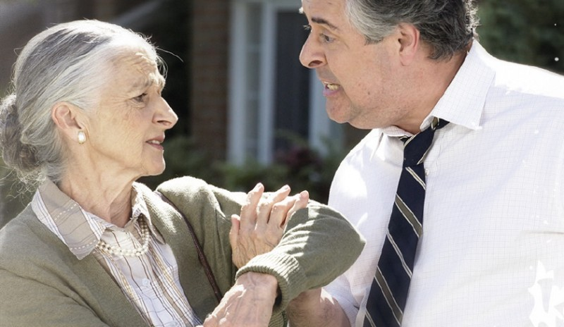 Image from Elder Abuse campaign. Shows man grabbing an elderly women's arm, raising awareness of elder abuse