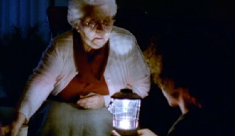 Image still from 72 Hours, a public safety marketing campaign for Public Safety Canada. Shows an elderly woman and her grandchild in the dark, holding a lamp