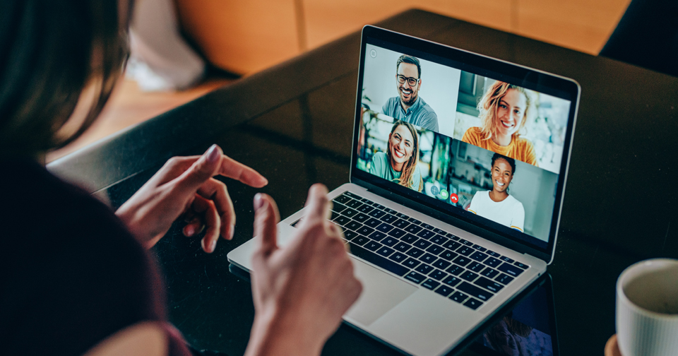 Woman talking to team over video chat